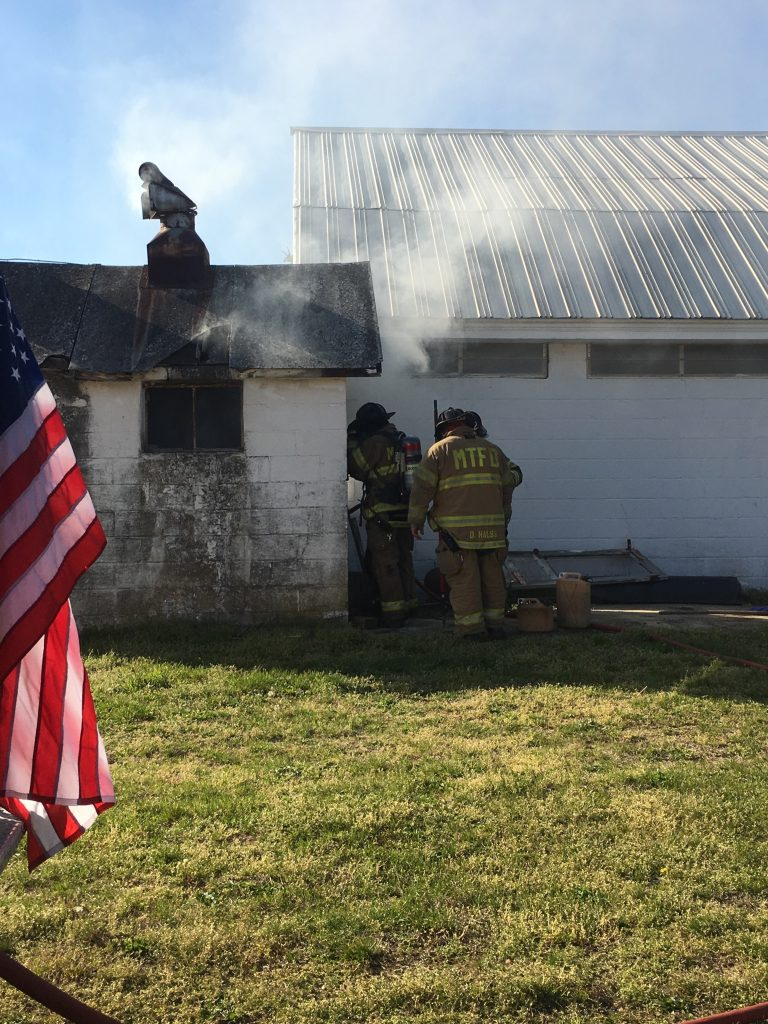 District Battles Working Shed Fire