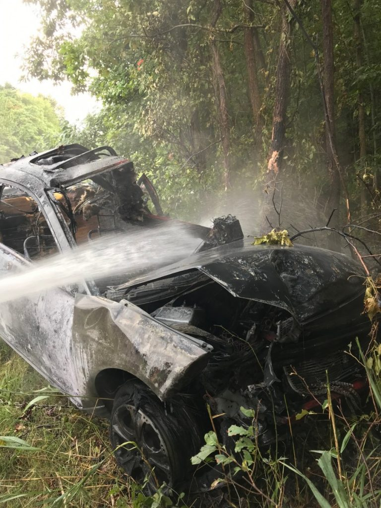 Vehicle Overturned with Fire